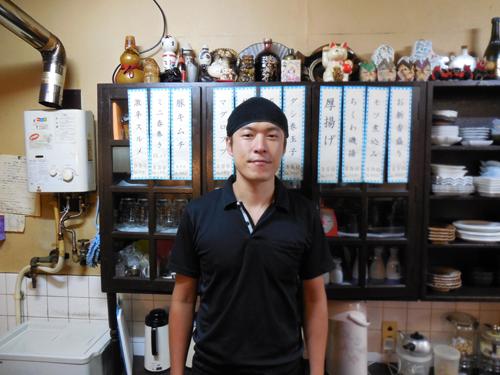 写真15:店長